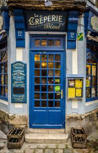 Blue door of creperie in Normandy